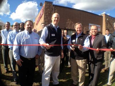 Caption  Ribbon cutting (l-r): Norm Gadomski, Service OEM Technician, Patrick McGovern, COO, Steve McGovern, President, Ian Abreu, New Bedford Chamber of Commerce