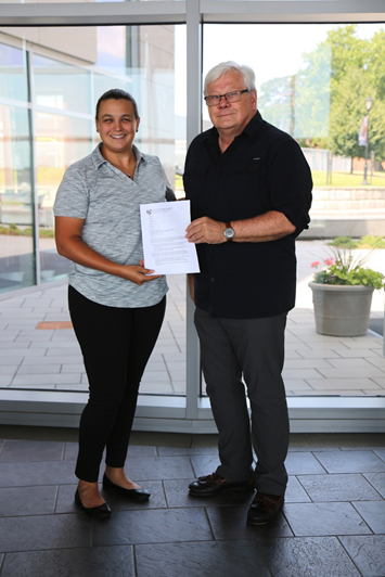 Rebecca Garcia-Malone, ASA Education Committee Chair, presents Dr. Richard J. Burke, ABS Professor of Naval Architecture & Engineering, SUNY Maritime College, with an official invitation to join the ASA as the very first honorary maritime faculty member representative, July 20, 2018 at SUNY Maritime College. (Photo: ASA)