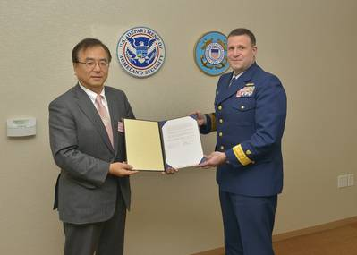 ClassNK Executive Vice President Dr. Takuya Yoneya (L) receives a copy of the Recognized Organization Agreement from U.S. Coast Guard Rear Admiral Joseph A. Servidio (R)