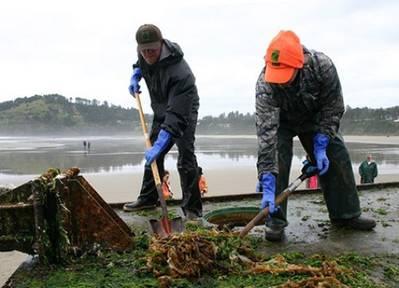 Clearing beached Japan Tsunami debris: Photo credit NOAA