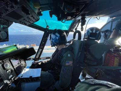 Coast Guard air crew prepare to conduct a medevac of a mariner 100 miles northwest of Oahu, December 4, 2020. (U.S. Coast Guard photo courtesy of Air Station Barbers Point)
