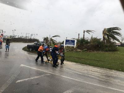 Coast Guard personnel help medevac a patient in the Bahamas during Hurricane Dorian. The Coast Guard is supporting the Bahamian National Emergency Management Agency and the Royal Bahamian Defense Force with hurricane response efforts. (Coast Guard Photo)