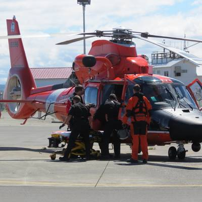 Coast Guard rescue crew members transfer an unresponsive individual to local Emergency Medical Service personnel after recovering him the water near the Strait of Juan de Fuca on July 10, 2018. (Photo: U.S. Coast Guard)