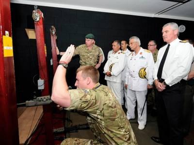 Commodore Hassan Ali Bushnak (Center) Photo credit: UK MOD