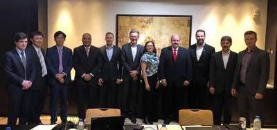 Consortium company executives at the agreement signing ceremony, left to right: Emmanuel Rousseau, GTT; Koichi Matsushita, MHI-MME; Kusakabe Atsuo, MHI-MME; Ibrahim Behairy, WinGD; Tommi Keskilohko, MacGregor; Stein Thorsager, Wärtsilä; Reetta Kaila, Wärtsilä; Mohamed Zaitoun, Zaitoun Green Shipping; Ari Viitanen, C4; Rudolf Wettstein, WinGD; and Arto Toivonen, MacGregor (Photo: Wärtsilä)