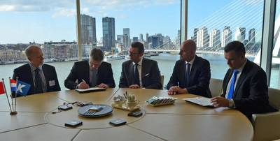 Contract signing: Photo Robert Allan