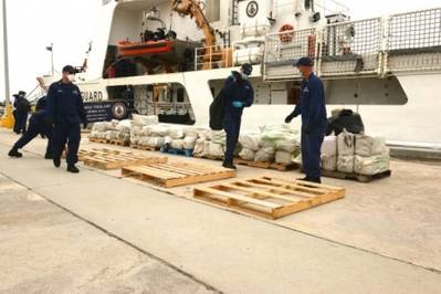Crew members aboard the Coast Guard Cutter Vigilant stack seized cocaine at Coast Guard Base Miami Beach, Florida, June 12. On May 22, the crew of the Vigilant and the Coast Guard Cutter Bear interdicted the cocaine worth an estimated wholesale value of $10.9 million. (USCG photo by Mark Barney)