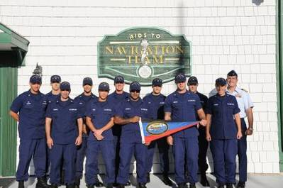 Crew members stationed at Aids to Navigation Team Jacksonville Beach Fla., and Capt. Tom Allan, commander of Sector Jacksonville, display the Sumner I. Kimball Award for excellence during an award ceremony held at the unit Friday, Aug. 9, 2013. (U.S. Coast Guard photo by Petty Officer 3rd Class Anthony L. Soto)