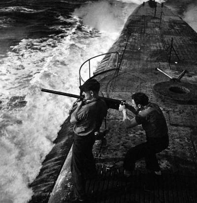 Crewmen firing 50 caliber machine gun on Batfish (SS-310) (U.S. Navy photo by Horace Bristol)