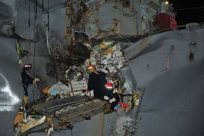 Damage to USS Porter: Photo credit USN