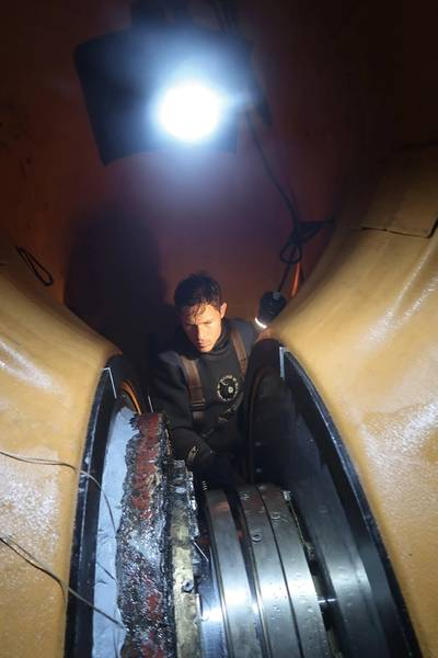 Hydrex diver/technician working inside flexible mobdock. Photo courtesy Hydrex