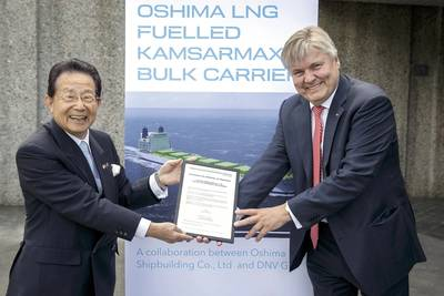 DNV GL Group President & CEO Dr Henrik O. Madsen (right) presents the CEO of Oshima Shipbuilding, Sho Minami, with the AiP certificate for the Japanese yard's LNG-fuelled Kamsarmax bulk carrier design