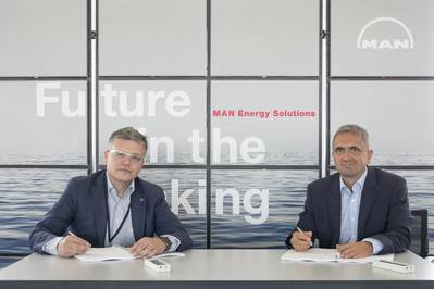 Dr. Otto Preiss (left ), Chief Technology Officer and COO of Rolls-Royce Power Systems, and Dr. Uwe Lauber, Chief Executive Officer of MAN Energy Solutions, have signed an agreement for a strategic partnership that will see MAN's PBST brand distribute state-of-the-art mtu turbochargers. (Photo courtesy Rolls-Royce)
