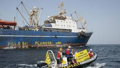 Earlier photo of Oleg Naidenov courtesy of Greenpeace