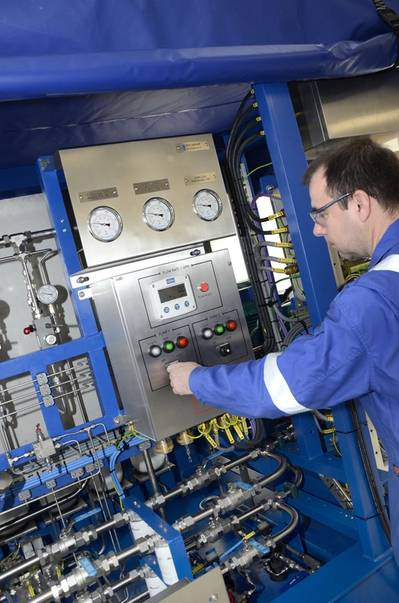 EFC Technician at work on Hydraulic Power Unit (HPU) at EFC Forres manufacturing facility