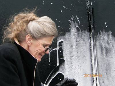 Ellen Boothe, wife of the vessel's namesake, Ken Boothe Sr., former General Manager of Donjon Shipbuilding & Repair LLC, who passed away unexpectedly during the first year of operations, christens the Ken Boothe Sr. at an event on April 10, 2012.