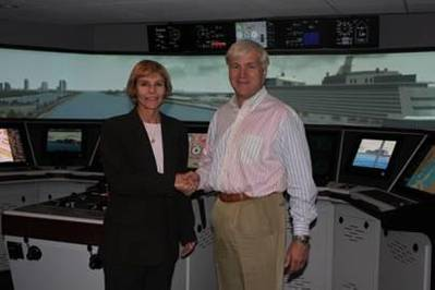 Denise Johnston, Director, Resolve Maritime Academy (left) and Svein Sleipnes, Senior Vice President, Marine Operations at Norwegian Cruise Line (right) at Resolve Maritime Academy's Simulation Training Center