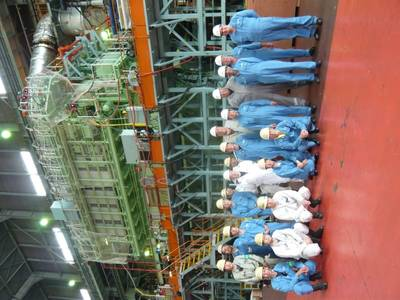 FAT attendees pictured in front of the ME-GI engine at MES's Tamano Works (Photo: MAN Diesel & Turbo)