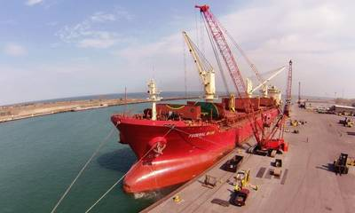 File image: a bulk vessel alongside during cargo operations (FedNav)