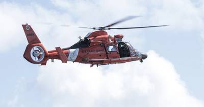 File Image: A USCG rescue copter in the air. (CREDIT: AdobeStock /  © Wollwerth Imagery)