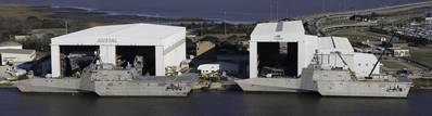 File Photo: LCS hulls 4 & 6 alongside the pier at Austal Shipyard..