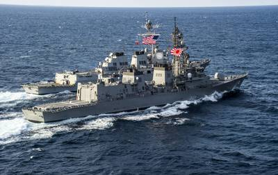 File photo: The Japan Maritime Self-Defense Force destroyer Takanami (DD 110), front, sails alongside the guided missile destroyer USS McCampbell (DDG 85) March 9, 2014, in the Pacific Ocean. (U.S. Navy photo by Chris Cavagnaro)