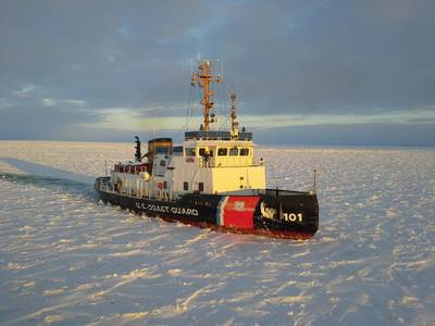 File photo: The US Coast Guard Cutter Katmai Bay, a 140-foot ice-breaking tug, escorts a motor vessel  through Lake Michigan near Lansing Shoal, in 2014. The cutter was operating as part of Operation Taconite, which is the icebreaking operation for the northern Great Lakes. (U.S. Coast Guard photo by Daniel R. Michelson)