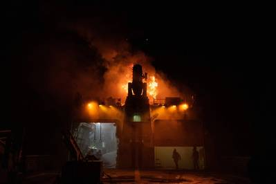 Firefighting teams combat flames on board the Coast Guard cutter Waesche in the Western Pacific Ocean. (Coast Guard photo by Aidan Cooney)