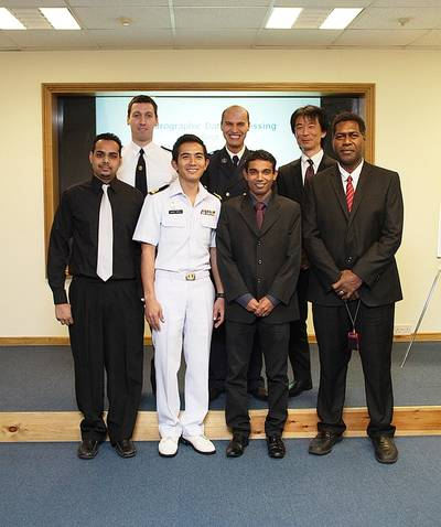 From left to right, back row: Nikolay Radoslavov Lyaskovski (Bulgaria); Mohamed Zabour (Algeria) and Yusuke Nagase (Japan). Front row: Dwight Nanan (Trinidad & Tobago); Sub Lt Uaychai Phothong (Thailand); Rahubadda Kankanamge Anura Ariyarathna (Sri Lanka) and John Dalomae (Solomon Islands).