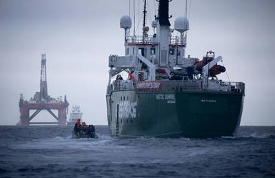 Greenpeace ship Arctic Sunrise follows the BP chartered Transocean drilling rig Paul B Loyd Jr en route to the Vorlich field in the North Sea. The environmental activism group is calling for BP to halt drilling for new oil. (© Greenpeace / Jiri Rezac)
