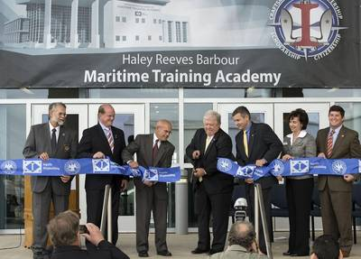 Haley Reeves Barbour (center), the former governor of Mississippi, officially opens the Maritime Training Academy, which bears his name. Also participating in the ribbon-cutting are (left to right) Mike Mangum, president, Jackson County Board of Supervisors; Mississippi State Sen. Brice Wiggins; Irwin F. Edenzon, president, Ingalls Shipbuilding; Mike Petters, president and CEO, Huntington Ingalls Industries; Dr. Mary Graham, president, Mississippi Gulf Coast Community College; and U.S. Rep. Stev