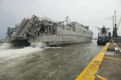 In 2014 the joint high-speed vessel USNS Spearhead (JHSV-1) maneuvers alongside the pier in Lagos, Nigeria. Spearhead took part in Obangame Express, a multinational at-sea exercise designed to improve cooperation among participating nations in order to increase counter-piracy capabilities. (U.S. Navy photo by Mass Communication Specialist Seaman Weston Jones/Released)