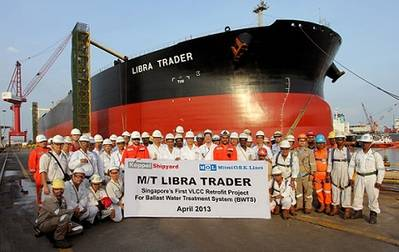 In front of the VLCC Libra Trader, which recently had a new ballast water treatment system installed, representatives of the vessel's management company, MOL Tankship Management (Asia) Pte Ltd., and the shipyard pose for a commemorative shot.