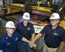 "Ingalls Shipbuilding celebrated ""start of fabrication"" for the U.S. Coast Guard National Security Cutter Hamilton (WMSL 753) at its Steel Fabrication Shop in Pascagoula, Miss. Pictured (left to right) are U.S. Coast Guard Lt. Dave Osborne, test lead, hull and electrical; Jim French, deputy program manager, NSC Programs; and Len Janowski, ship design manager, Surface Ship Combatants."