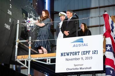 Ships' sponsor Charlotte Marshall smashing the champagne bottle at the christening ceremony for the future USNS Newport (EPF12) at Austal USA's shipyard in Mobile, Alabama. (Image: Austal USA)