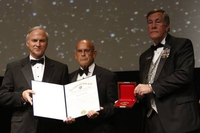 Irwin F. Edenzon (center) accepts the Fleet Admiral Chester W. Nimitz Award from Rep. Randy Forbes (left) and James H. Offutt, national president of the Navy League of the United States, Tuesday night in National Harbor, Maryland. Photo courtesy of the Navy League of the United States