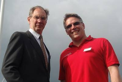 Isle of Wight MP Andrew Turner (left) and Jason Hayman, MD of Sustainable Marine Energy (right) after running up the flag to celebrate the opening of Sustainable Marine Energy's new offices and workshops at Trinity Wharf, East Cowes.