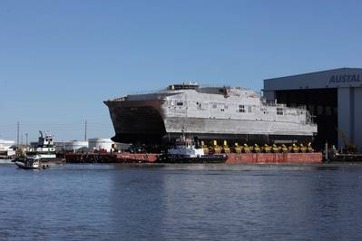 JHSV 4 rolls out of Austal final assembly on Berard Transportation transporters onto a launch barge (photo: Austal)