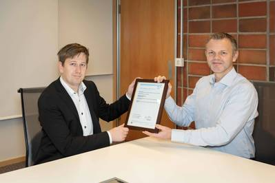 Knut Omberg, Principal Engineer at DNV GL – Maritime (left), presents Roar Simensen, Product Adviser - Connected Vessels & Information management at Kongsberg Maritime (right), with the new type approval. (Photo: DNV GL)