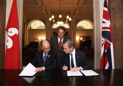 Left: Chan Fan, Frank, JP, Secretary for Transport & Housing, Hong Kong Government; right: Maritime London Chairman,  Lord Mountevans ; back: UK Minister of State for Transport Legislation and Maritime, John Hayes, CBE, MP. (Photo: Maritime London)