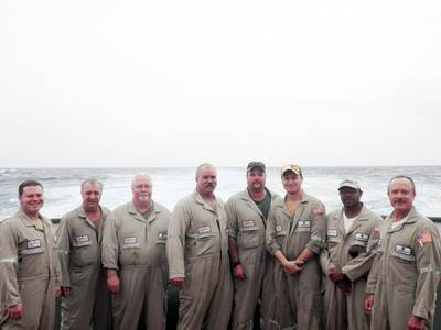 left to right: Alan Williams, AB; Doug Carson, third mate; Pat McGee, cook; Ron Robinson, chief mate; Chris Farmer, AB/tankerman; Vince Mull, chief engineer; Travis Stringer, AB/tankerman, and  Gus Cramer, captain.
