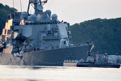 The Arleigh Burke-class guided-missile destroyer USS Fitzgerald (DDG 62) returns to Fleet Activities (FLEACT) Yokosuka following a collision with a merchant vessel while operating southwest of Yokosuka, Japan. (U.S. Navy photo by Peter Burghart)