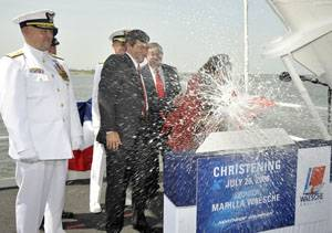 Marilla Waesche Pivonka (right), ship's sponsor, breaks a traditional bottle spraying the bow and platform guests at the christening of the Northrop Grumman-built U.S. Coast Guard National Security Cutter Waesche (WMSL 751). The ship is named for her grandfather, Adm. Russell Randolph Waesche, who served as the commandant of the U.S. Coast Guard from 1936 until 1946. Also on the platform are (left to right) U.S. Coast Guard Commandant Adm. Thad Allen; Mike Petters, vice president and president o