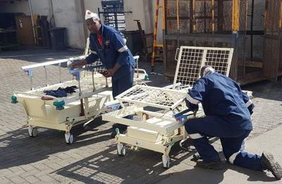Members of Namdock's technical and fabrication teams working to refurbish hospital beds for Walvis Bay's state hospital (Photo: Namdock)
