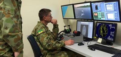 Members of the Australian Defense Force training at one of the 12 NAUTIS desktop stations at the Townsville base