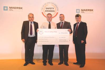 Neal Stone, director of policy and communications for the British Safety Council, with Pete Sheves, general manager of on-site machining & bolting for Stork Technical Services, being presented with the £5,000 winner's check by Les Linklater, team lead for Step Change in Safety and Robert Paterson, health and safety director for Oil & Gas UK. (Photo: Stork).