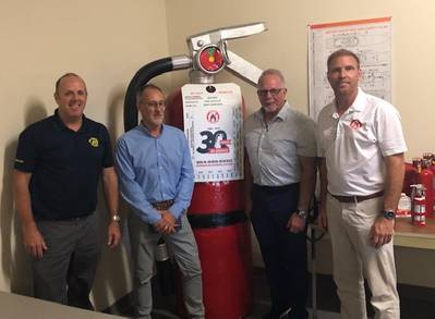 New Resolve Partners Chauncey Naylor (director of the Resolve  Academy), Stacy Payne (Resolve) and Glyn Day and Neil Cooper both with Fire Ranger. The Large Fire Extinguisher is called Big Red. (Image: Resolve Marine)