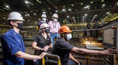 Ingalls shipbuilder Jason Jackson starts fabrication of steel for the newest Legend-class national security cutter Friedman (NSC 11). Also pictured, from left, are Cmdr. Christopher Lavin, acting commanding officer, PRO Gulf Coast; Amanda Whitaker, Ingalls NSC ship integration manager; and Dianna Genton and Braxton Collins, Ingalls hull superintendents. (Photo: Derek Fountain / HII)