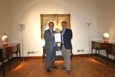Nick Davis, CEO of GoAGT, receiving ISO/PAS 28007 certificate from David Derrick, LRQA's UK Business Centre Manager.