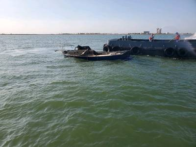 Offshore supply vessel Erin T alongside a fire-stricken boat near the Houston Ship Channel entrance in Galveston, Texas (Photo: U.S. Coast Guard)